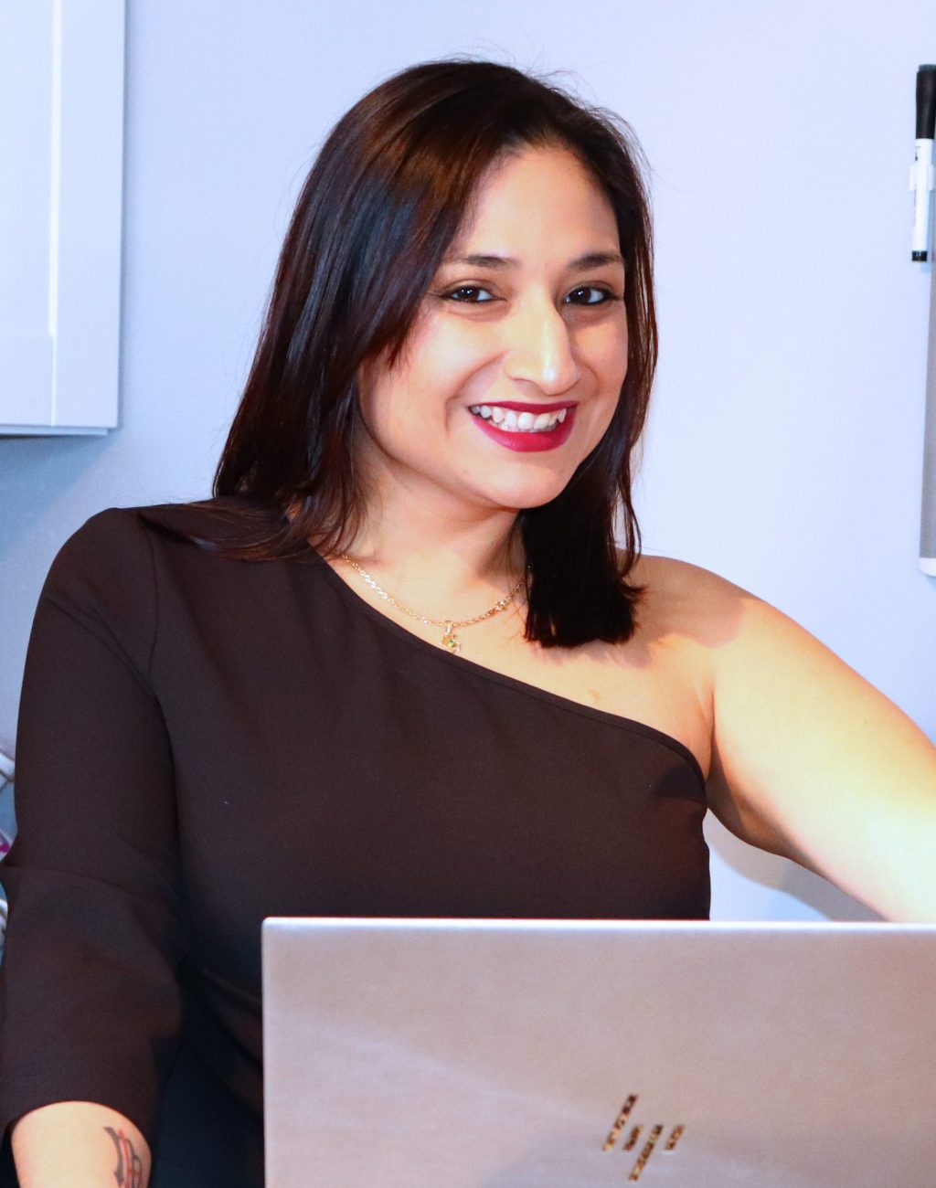 stephanie-smiling-at-computer